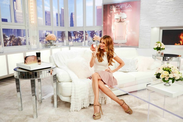 Sofia on couch holding fragrance