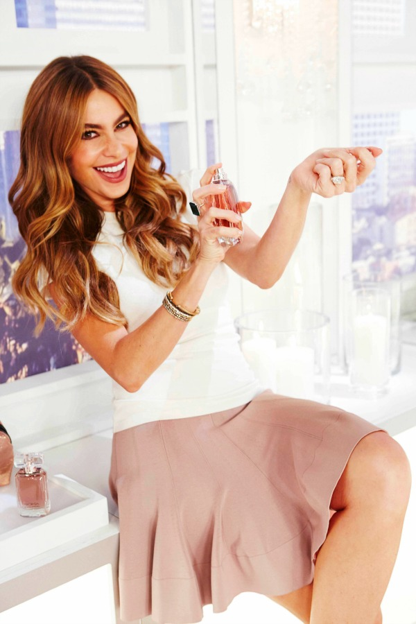 Sofia spraying the fragrance 2